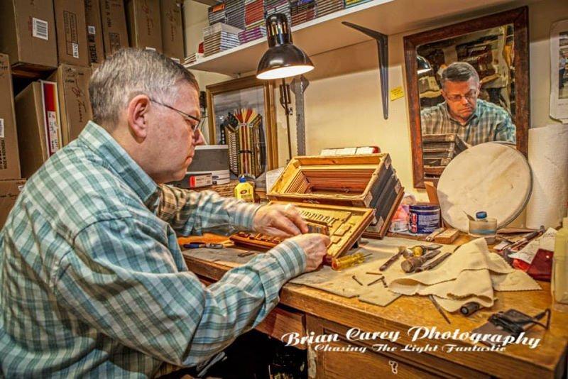 Gordon Repairing Accordian   O'Brien's Music Store